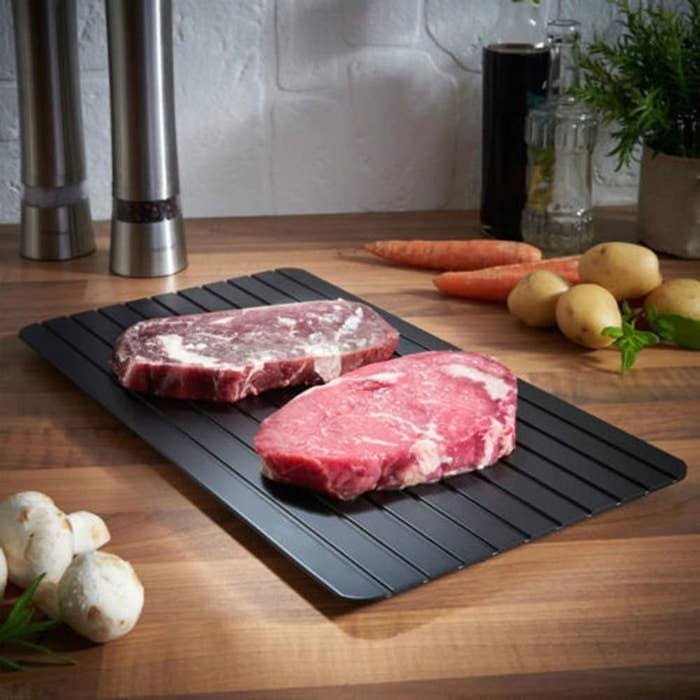 Meat on defrosting tray