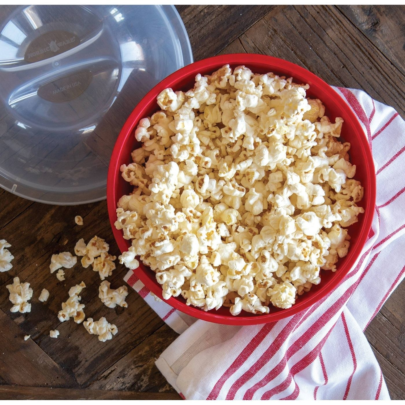 red popcorn maker with fresh popcorn in it
