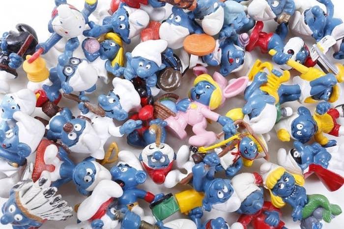 Three dozen Smurf PVC toys in a pile