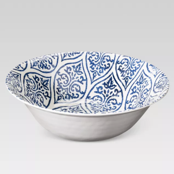 Glass bowl with its edged curved outward and a whimsical pattern inside