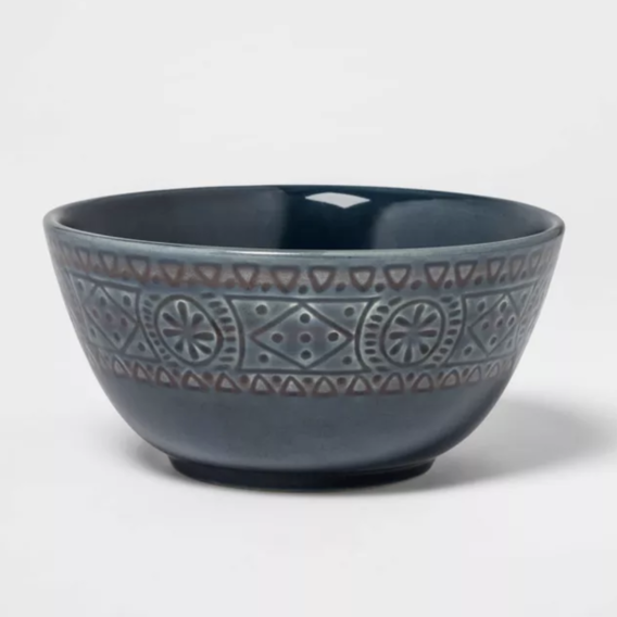 Ceramic bowl with a deep chasm and a bohemian-style band around the outside