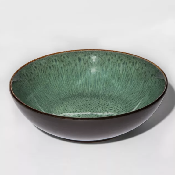 Ceramic bowl with a pottery feel and bohemian design on the inside