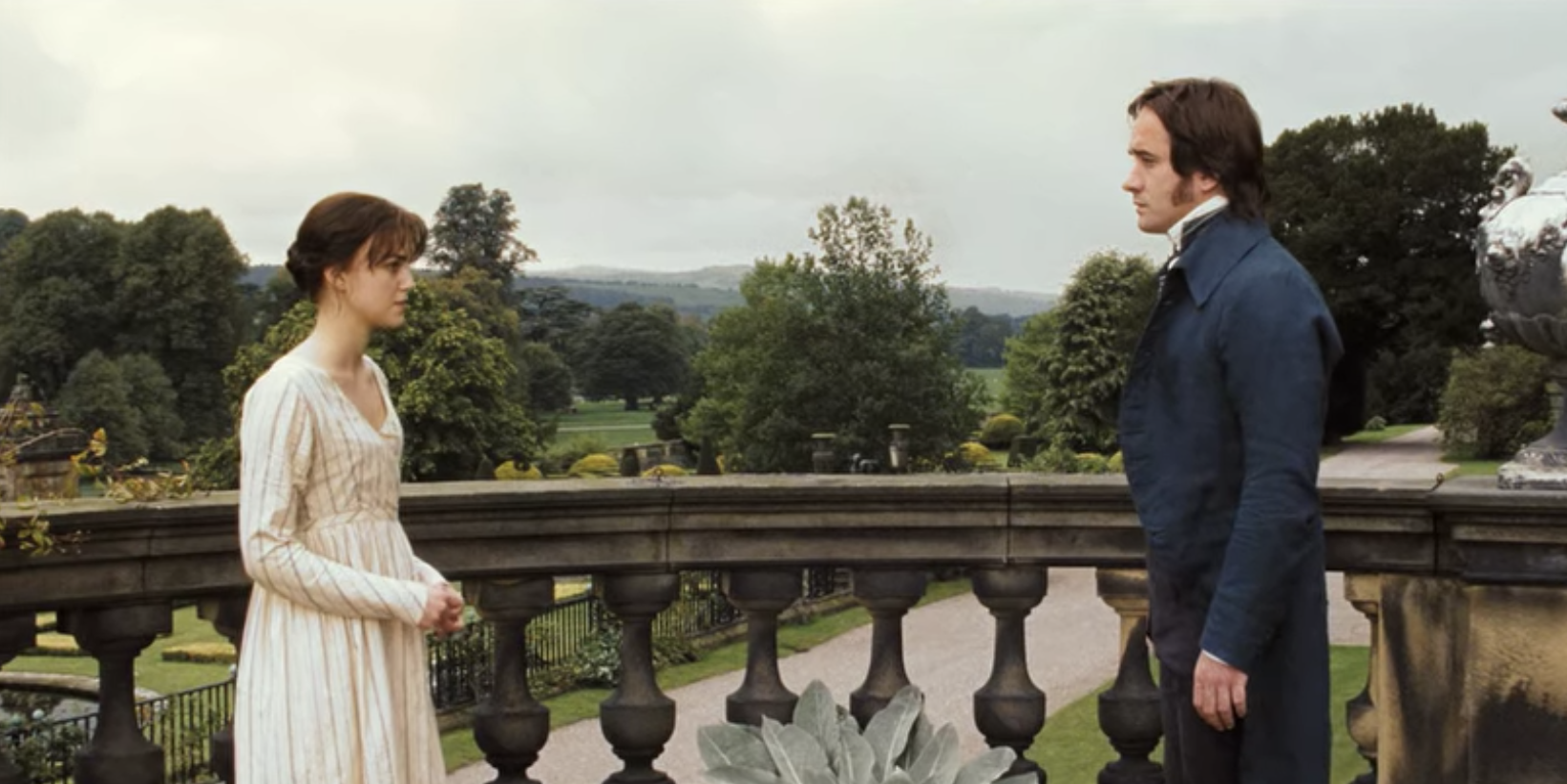 Lizzie and Mr. Darcy exchanging words on the balcony at Pemberly.