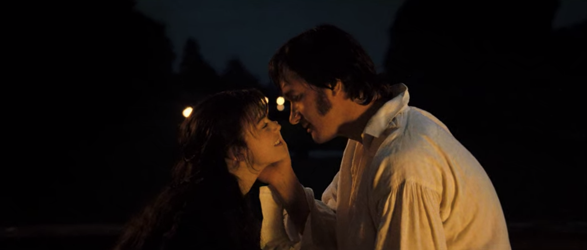 Mr. Darcy caressing Lizzie's face.