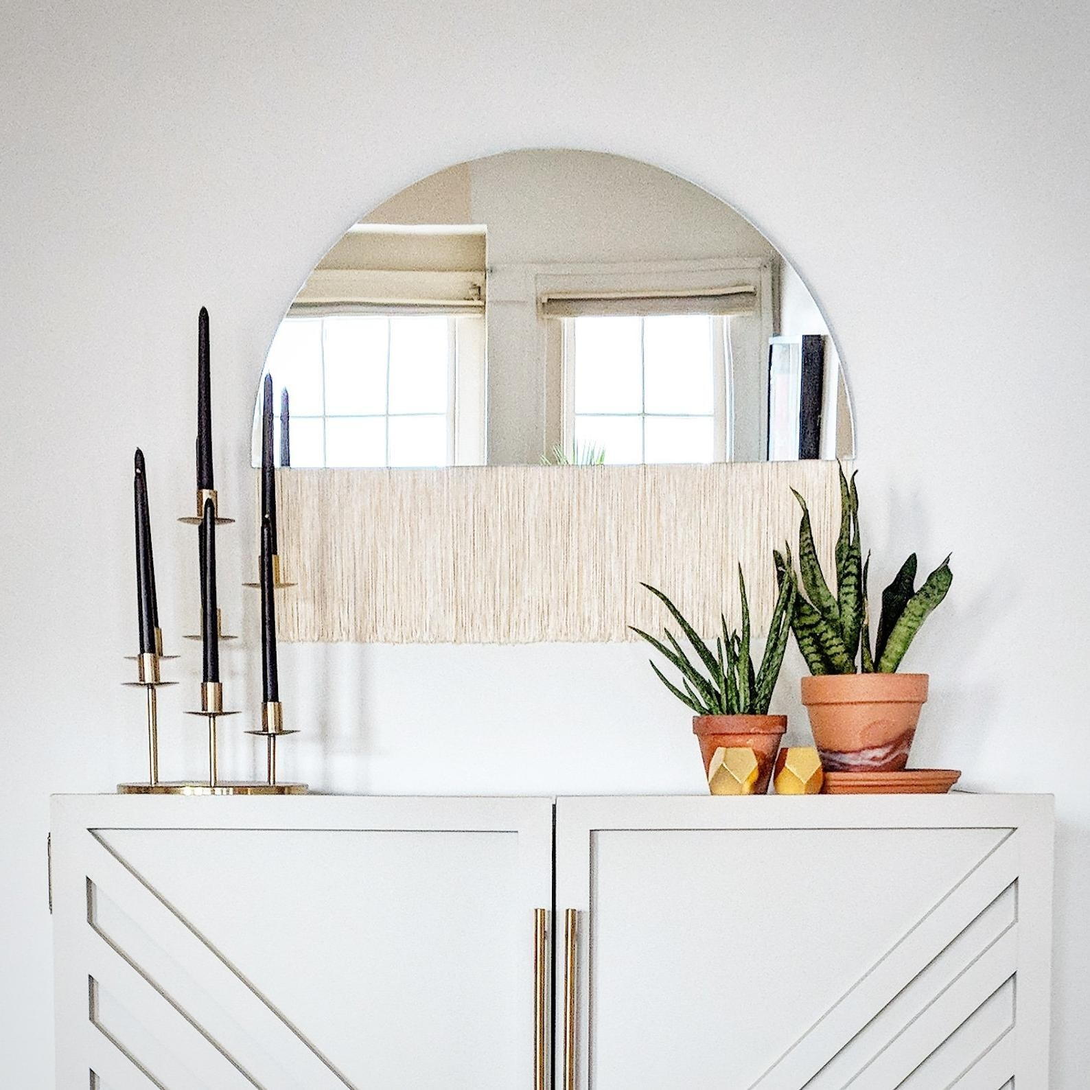 The fringe mirror hanging on a wall
