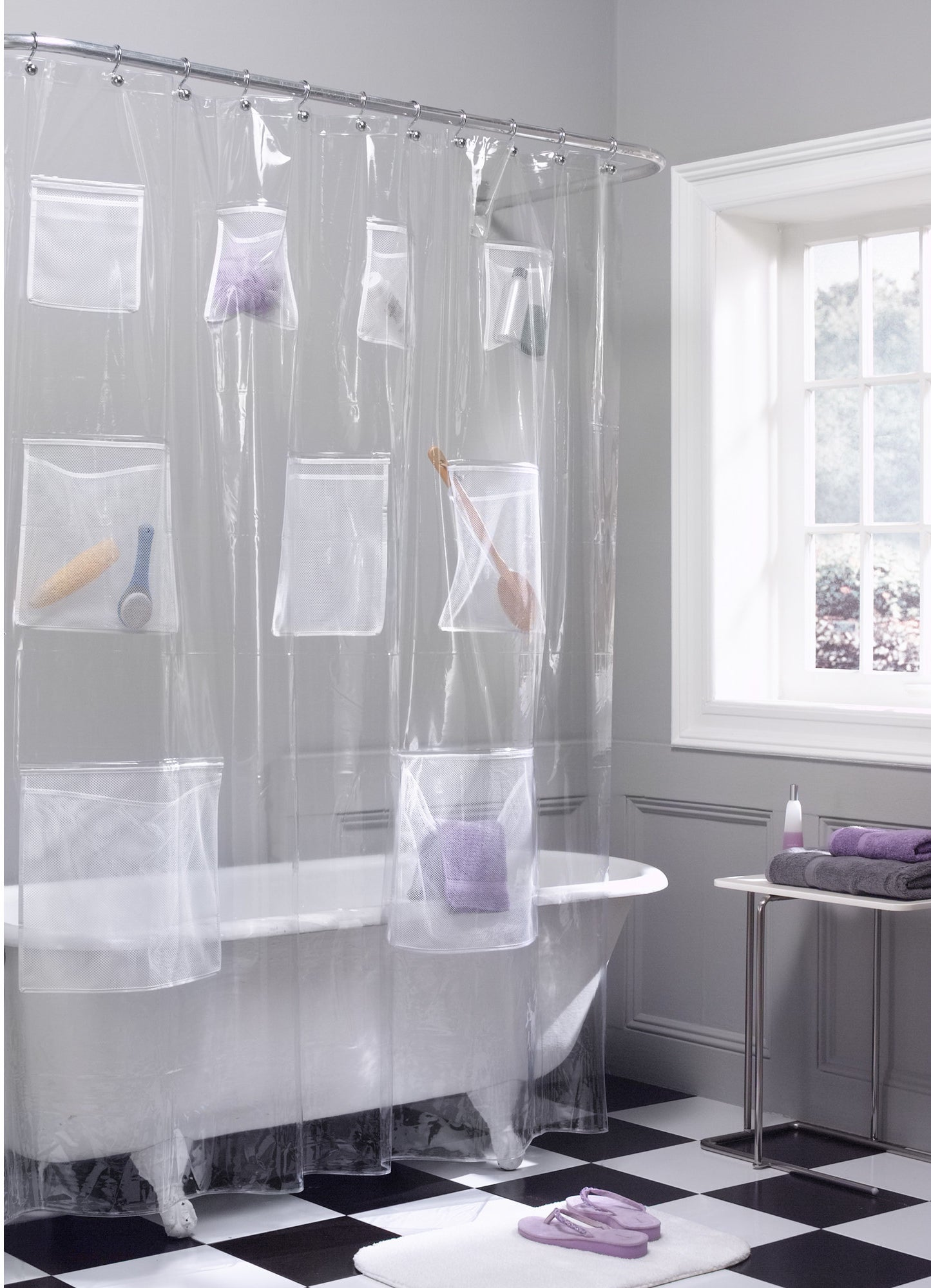 clear shower curtain with mesh pockets in a bathroom