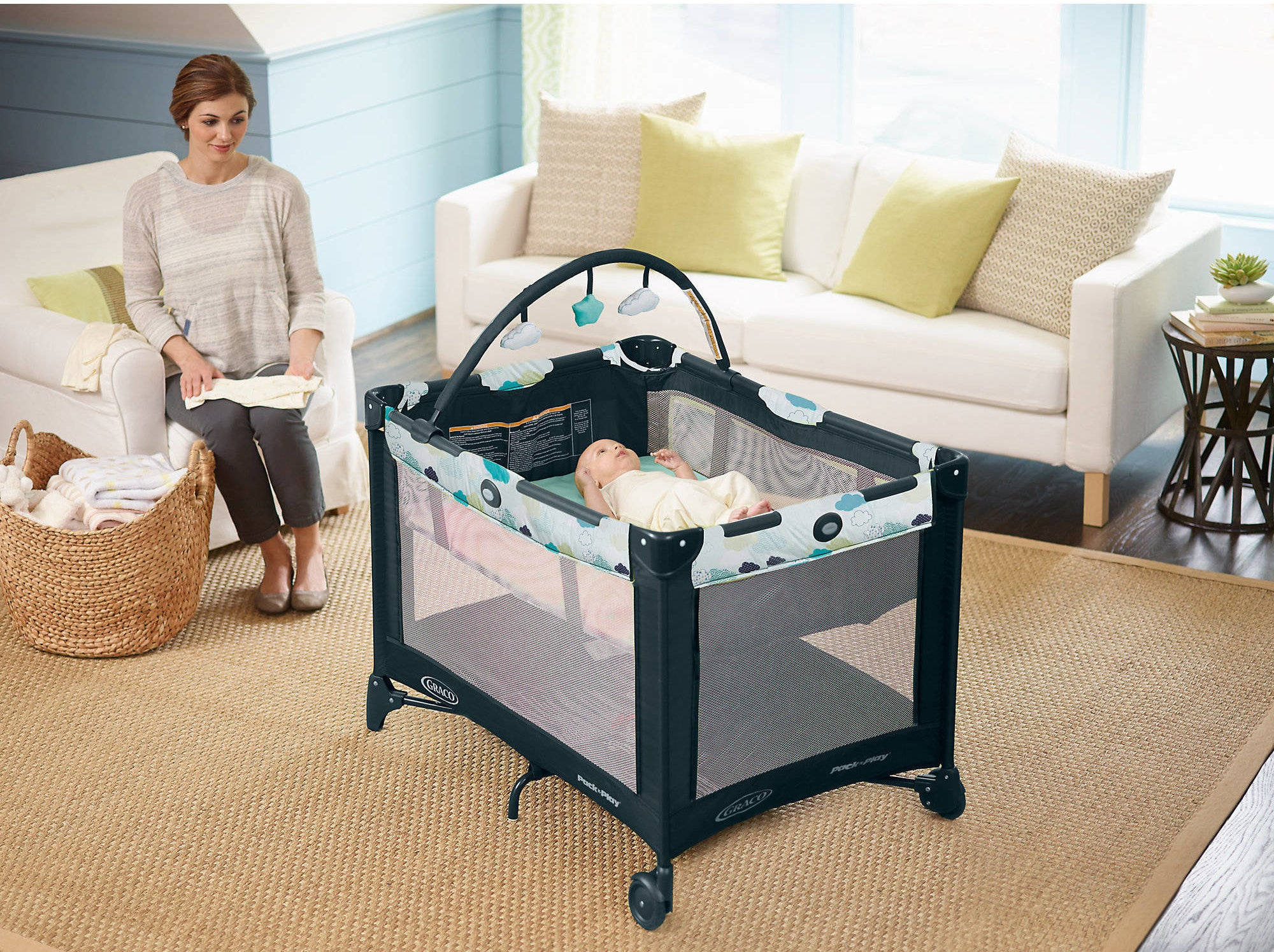 graco pack n play with a child in the bassinet