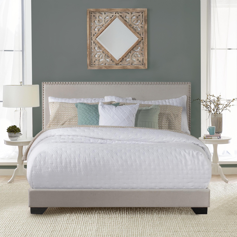 beige upholstered bed in a bedroom