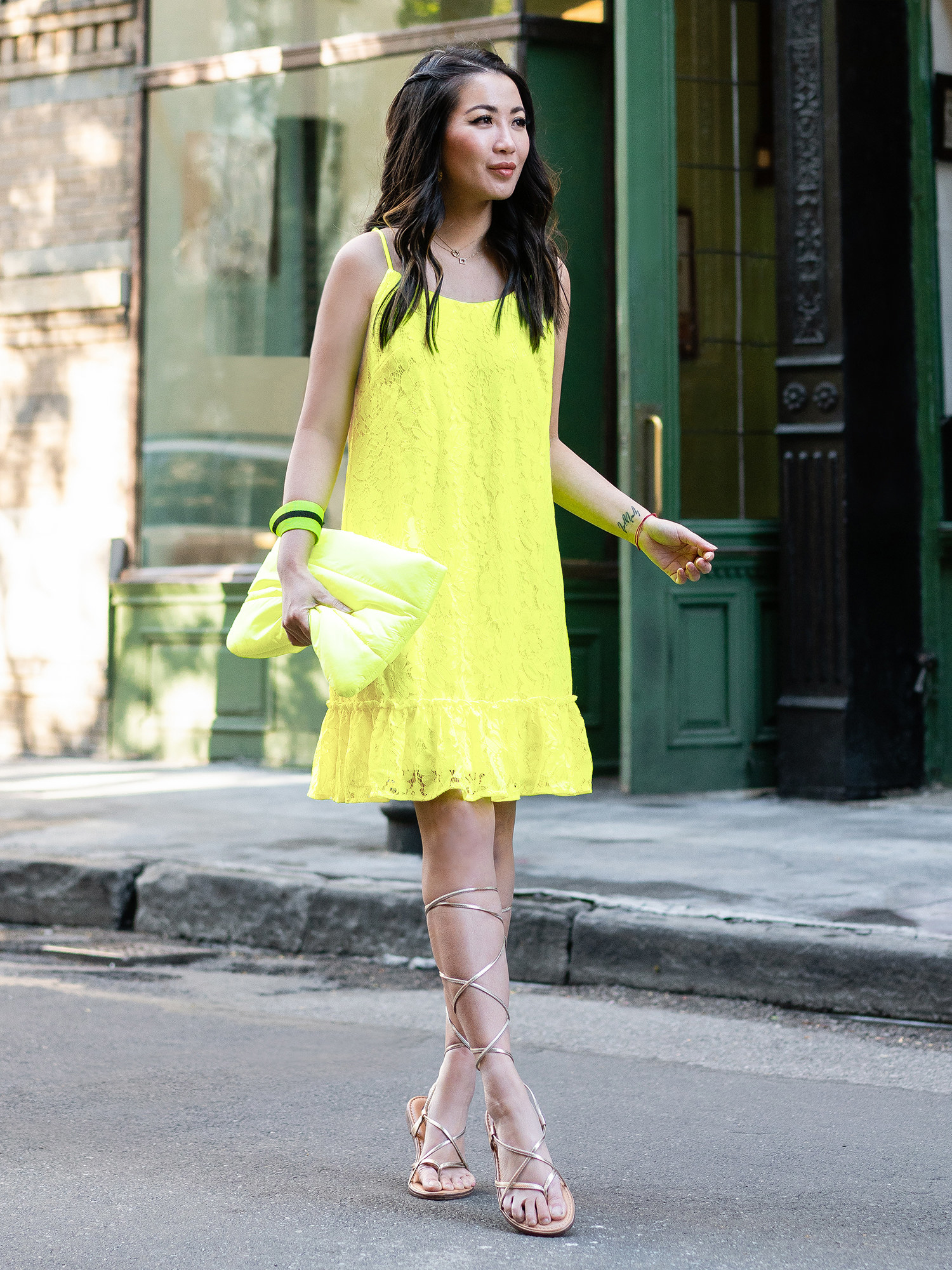 person wearing a neon yellow dress while walking down the street