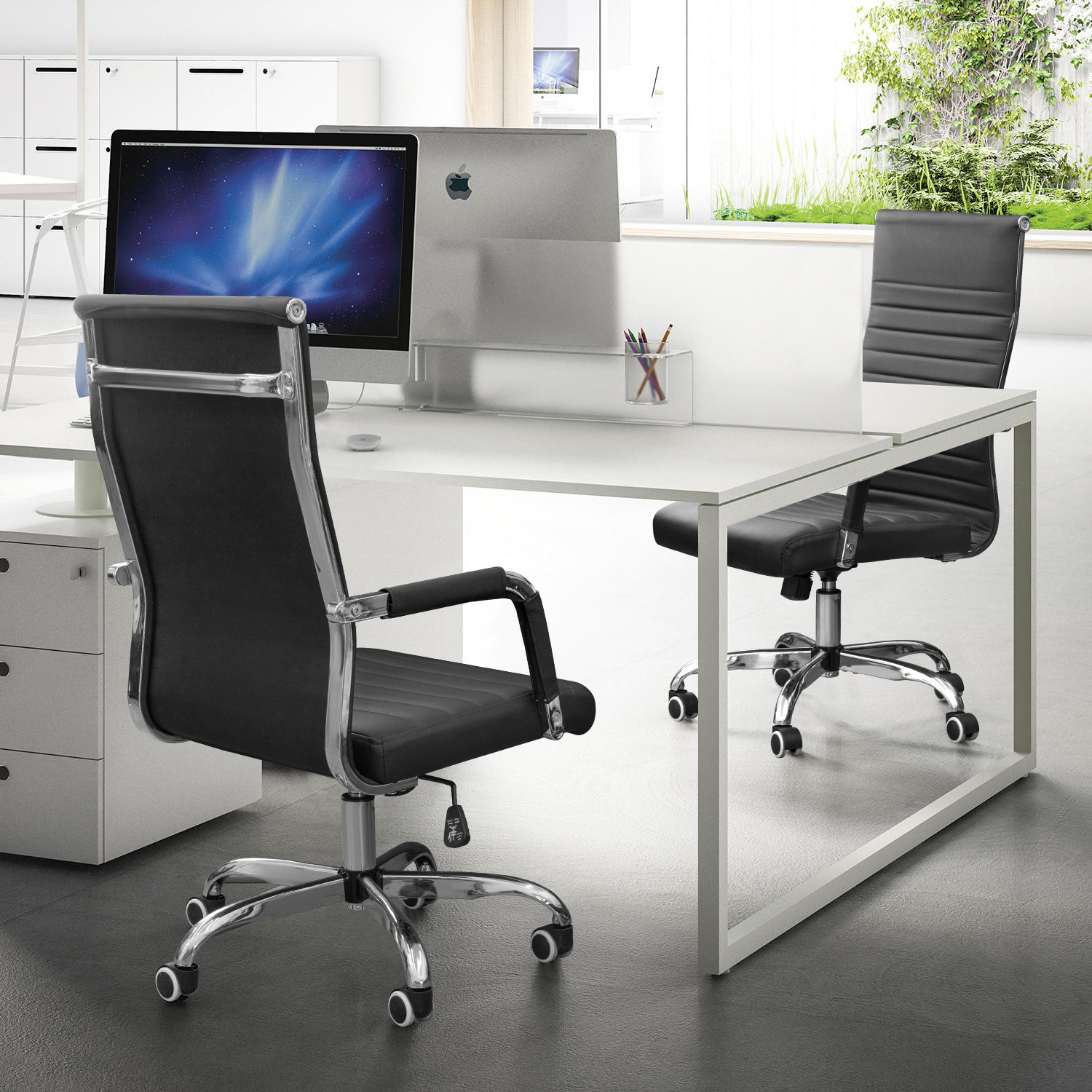 two black rolling office chairs in an office space