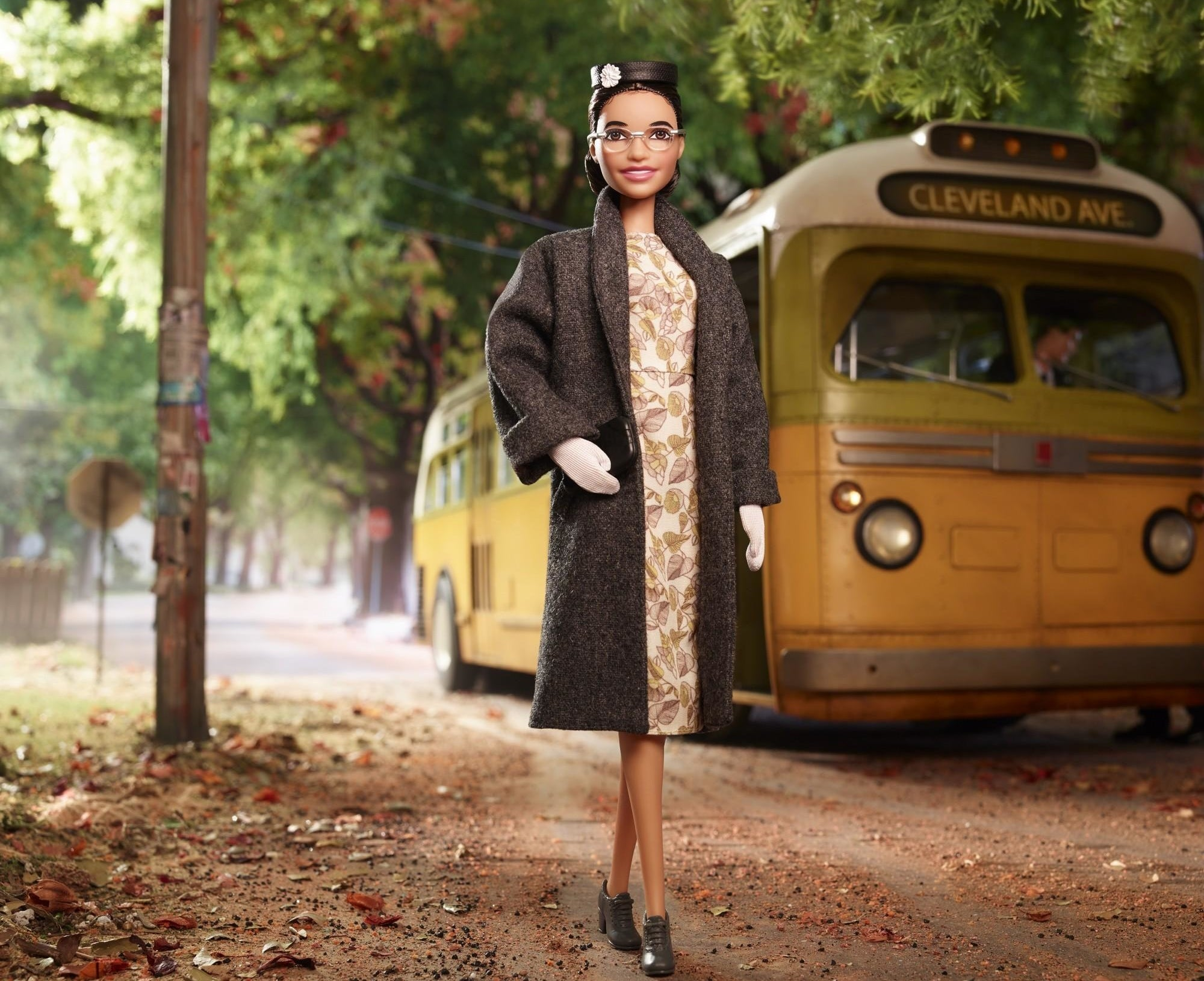 rosa parks barbie doll with a bus in the background