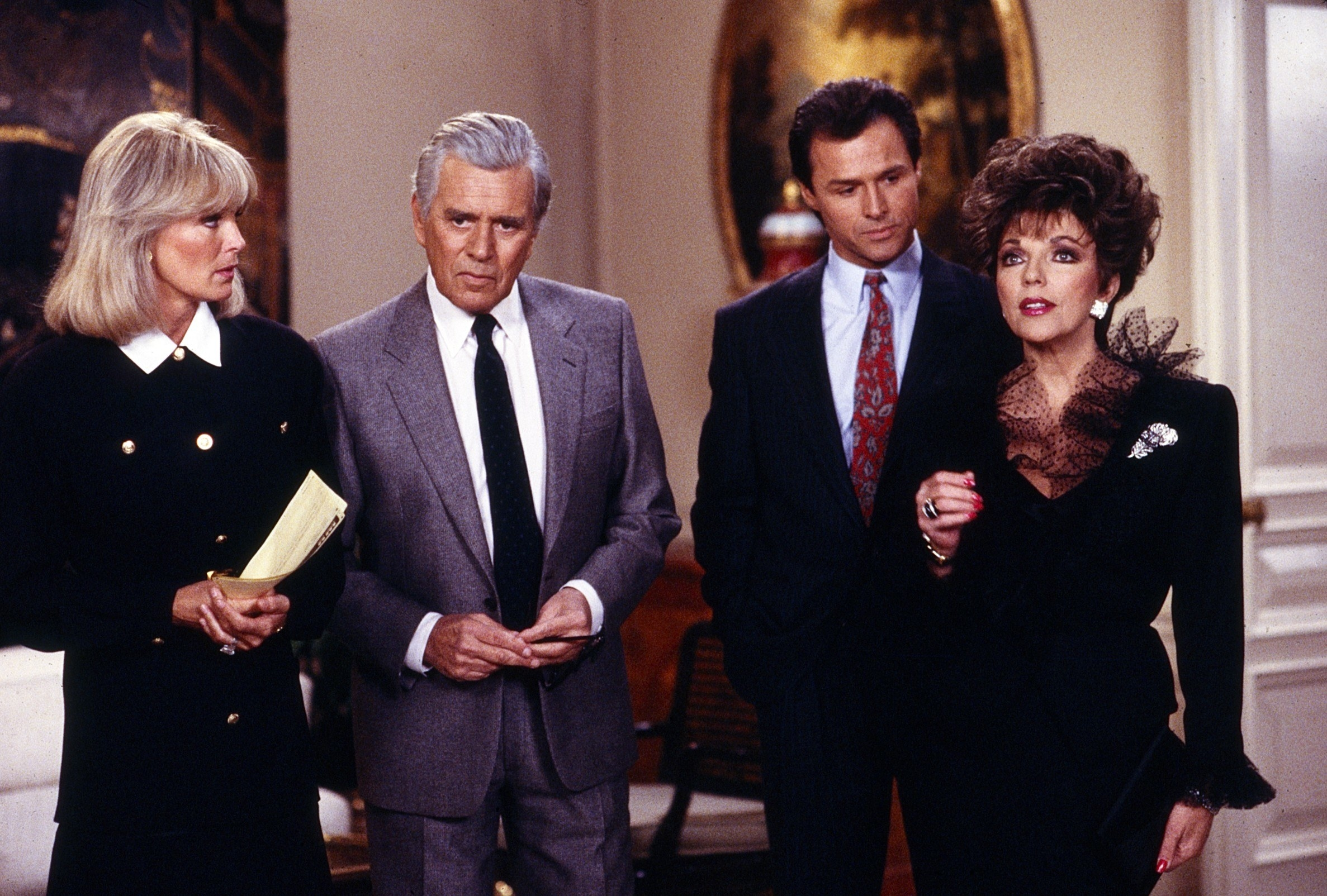A photo from Dynasty of Crystal, Blake, Dex, and Alexis standing the living room of the Carrington manor