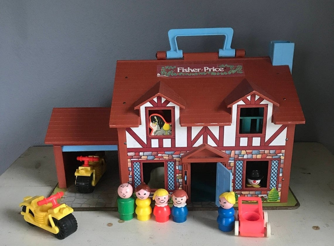A Tudor style Fisher-Price Little People Family Playhouse