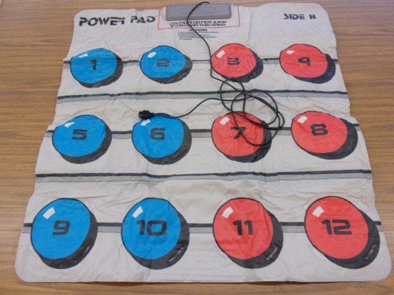 A Power Pad extended on a wood floor