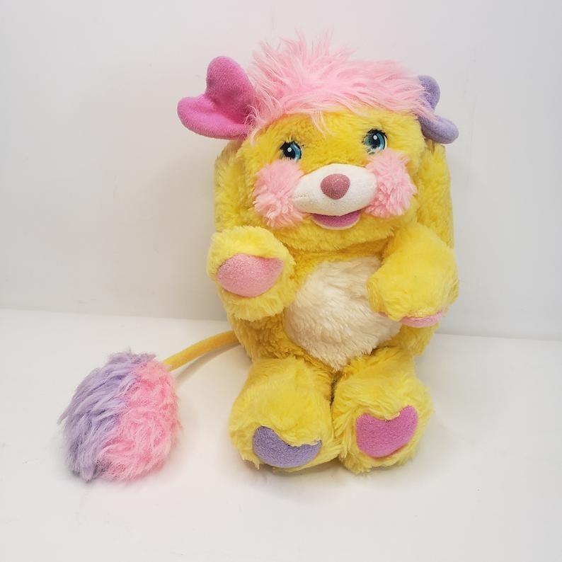 A yellow Popple stuffed animal