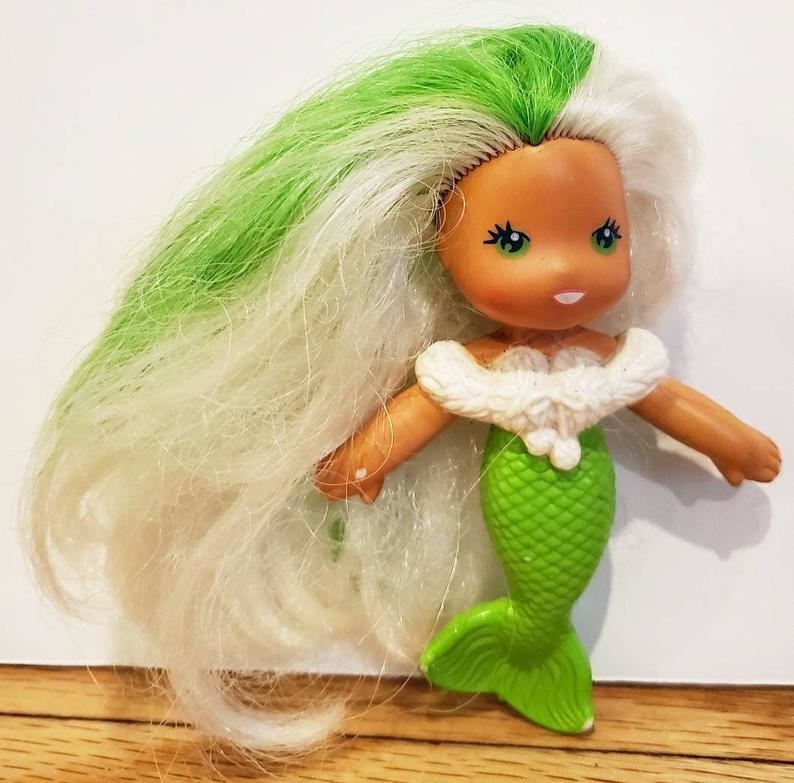 A Sea Wee mermaid doll with white hair and green streak