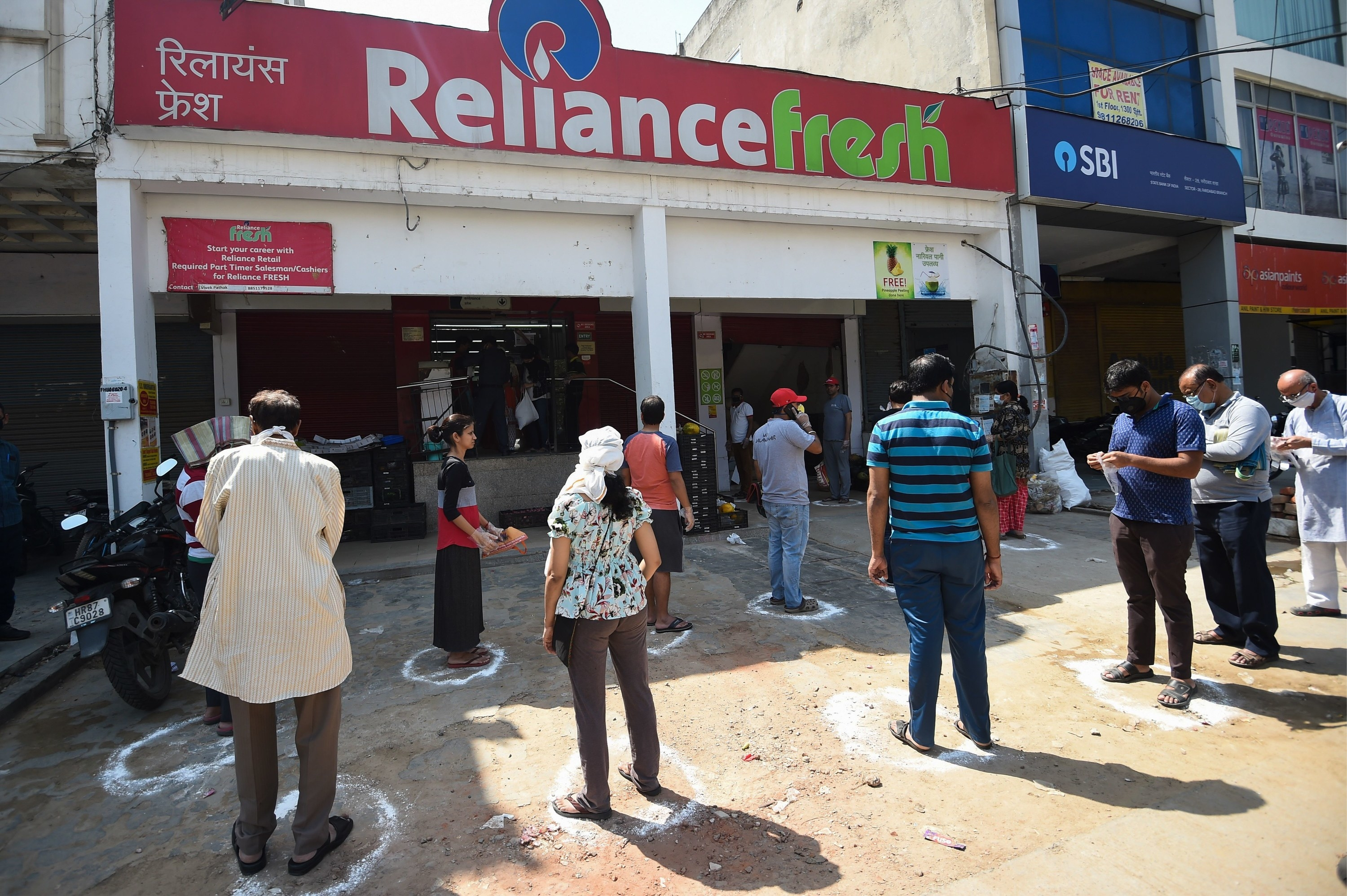 The line outside of a Reliance Fresh supermarket