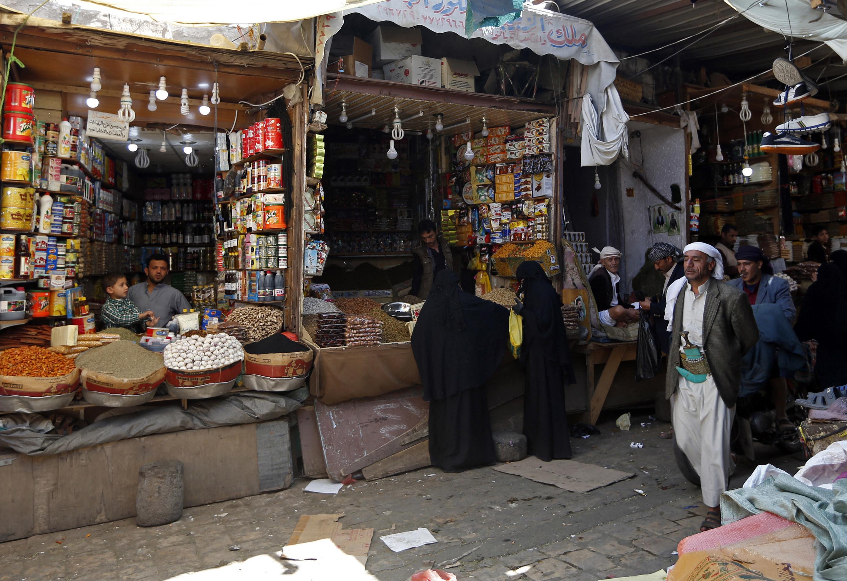 People shop at market stalls