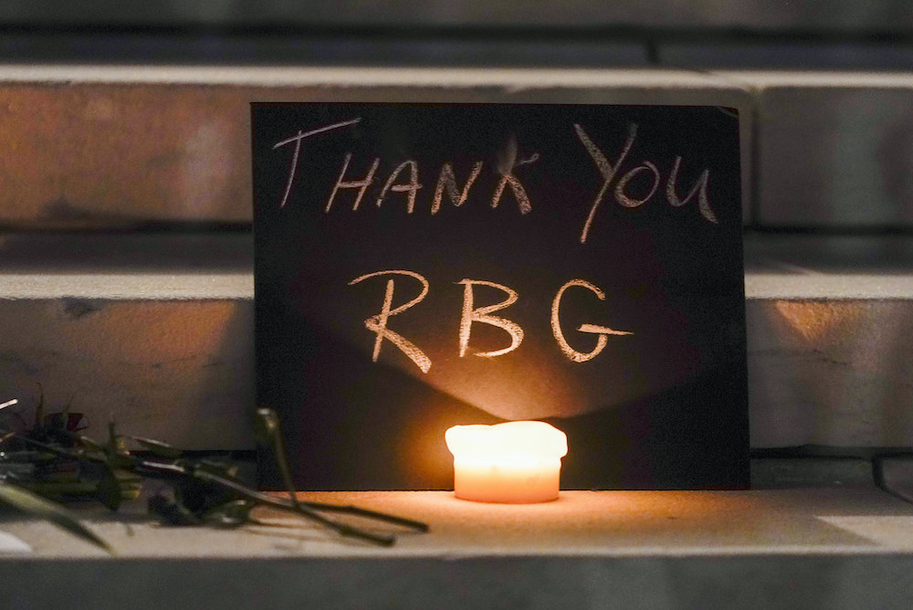 "A sign on the Supreme Court steps reads ""Thank You RBG"""