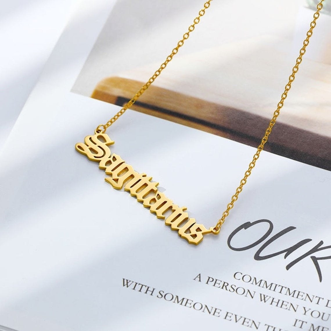 The nameplate necklace on top of a book