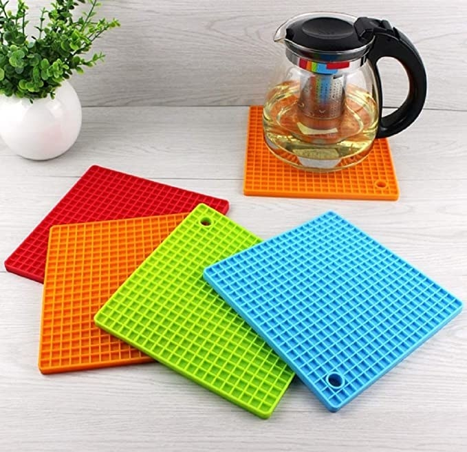 Teapot placed on the silicone mat on a table with the other silicone mats in front of it