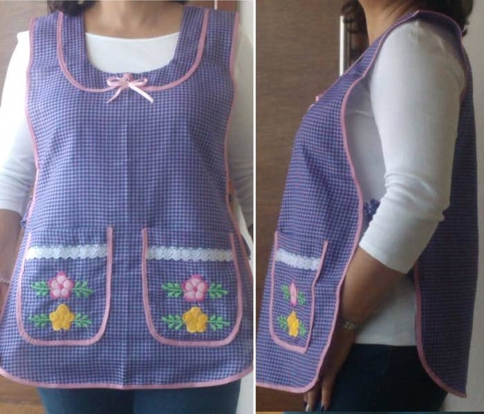 A woman wearing a purple embroidered gingham aparon