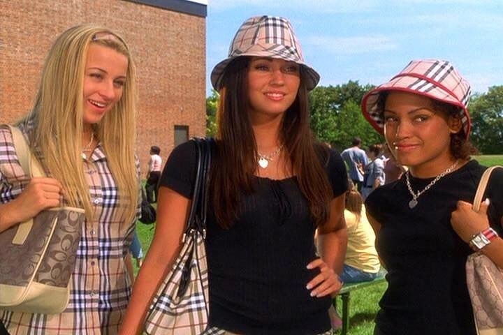 "Ashley Leggat, Megan Fox, and Barbara Mamabolo all wear plaid clothing, including plaid fedoras, as Marcia, Carla, and Robin in ""Confessions of a Teenage Drama Queen"""