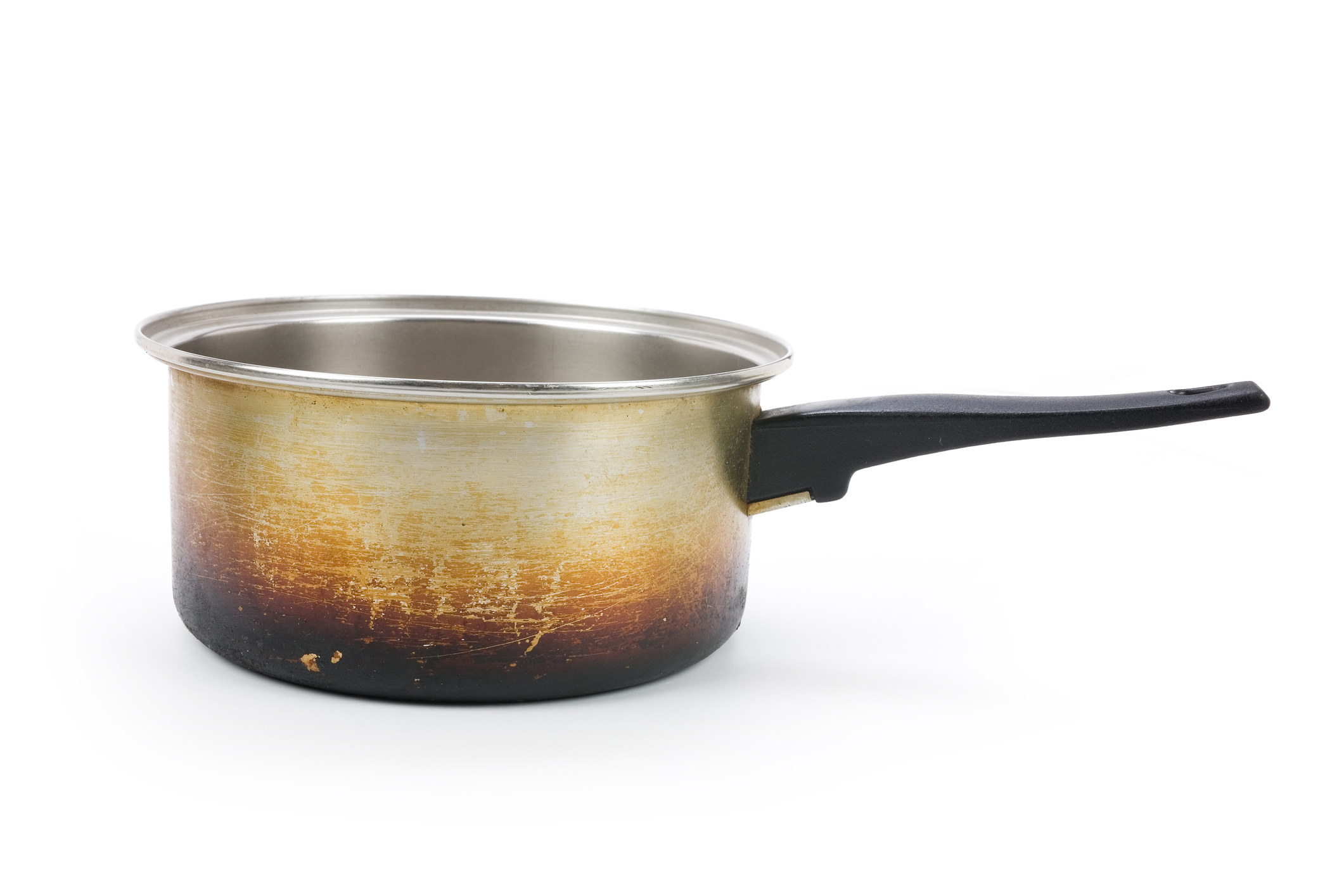 A sauce pan that has a burned bottom from years of use