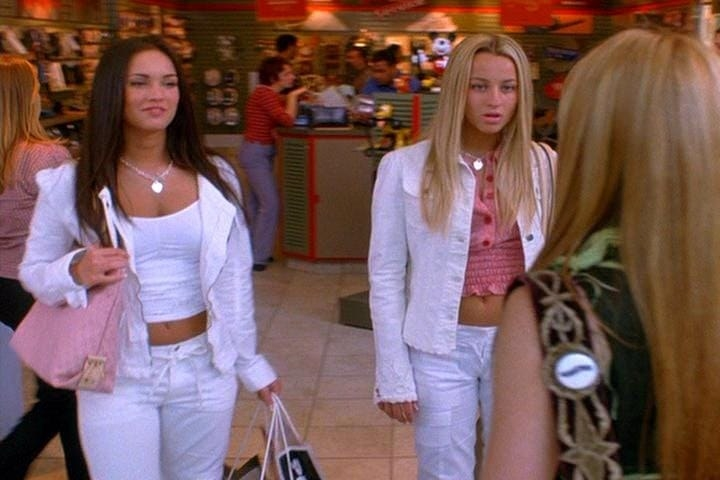 "Megan Fox and Ashley Leggat wear white pants with white jackets and matching heart-shaped lockets as Marcia and Carla in ""Confessions of a Teenage Drama Queen"""