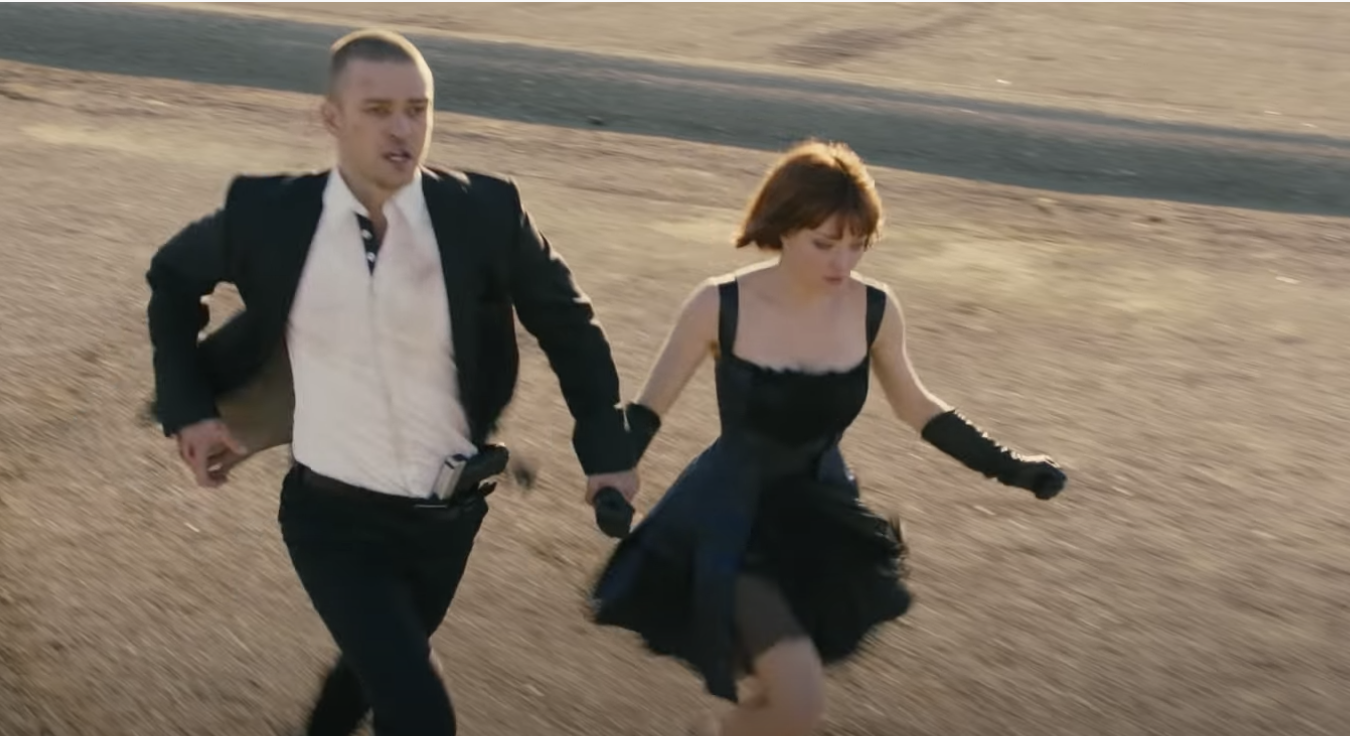 Justin Timberlake and Amanda Seyfried hold hands and run in the film