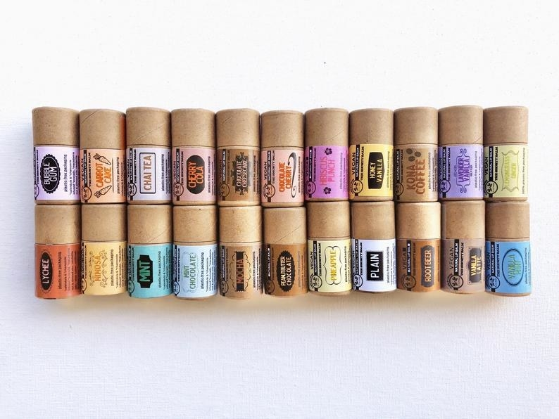 22 of the eco-friendly lip balms stacked on top of each other in two rows