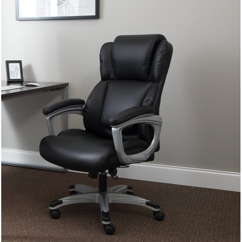 The black chair, which has padded armrests