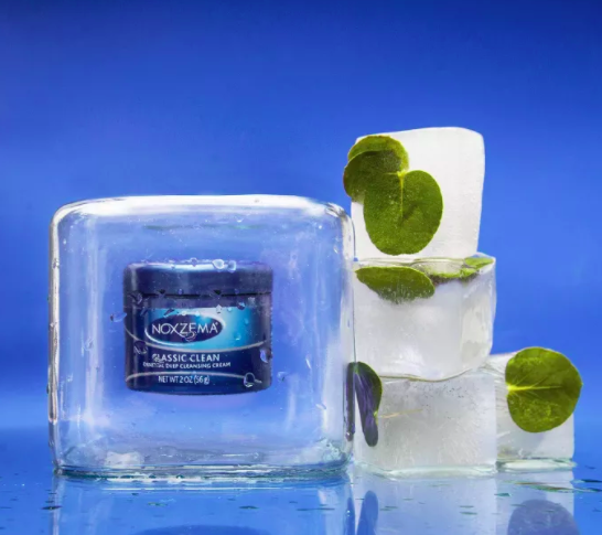 Product photo showing Noxzema classic clean cleanser styled in a cube of ice