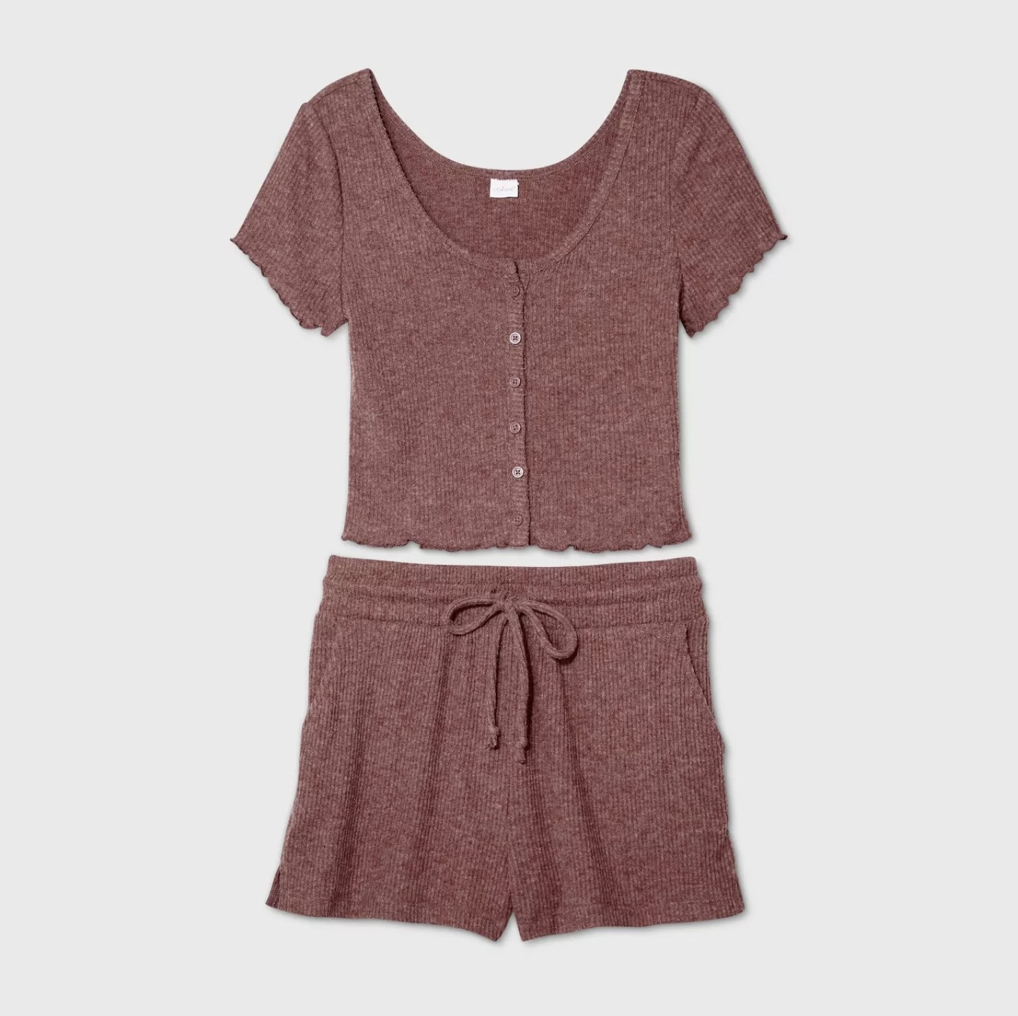 A mauve pajama set consisting of a ribbed short sleeve top with a button-front design and drawstring shorts
