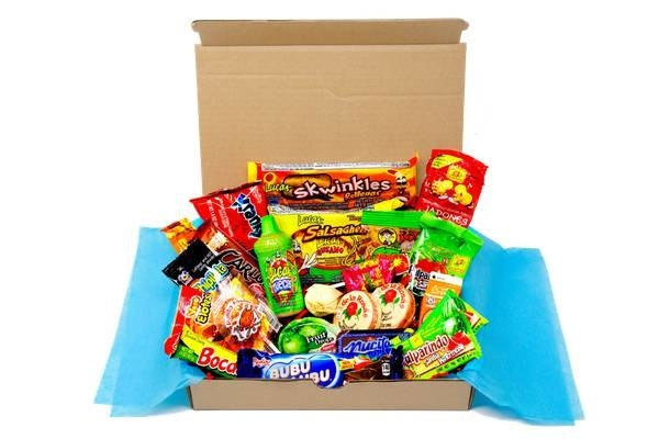 A MexiCrate box filled with a wide assortment of Mexican snacks