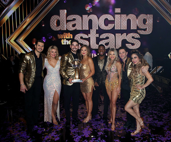 last year's cast of DWTS with Hannah Brown holding the Mirrorball