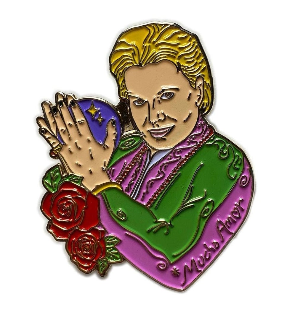 A pink- and green-clad Walter Mercado pin with red roses