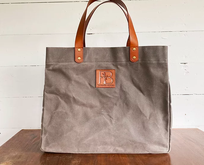 grey square bag with brown straps