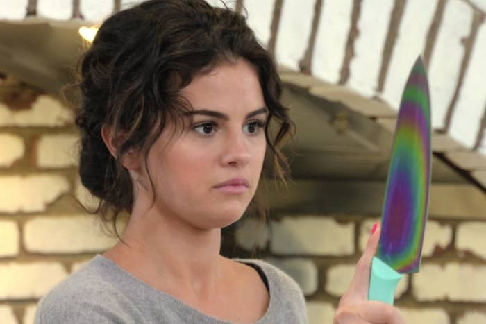 "Selena Gomez holding a rainbow knife on her show ""Selena + Chef."""