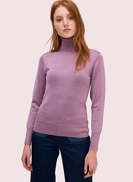 A model wearing a lilac turtleneck with long sleeves