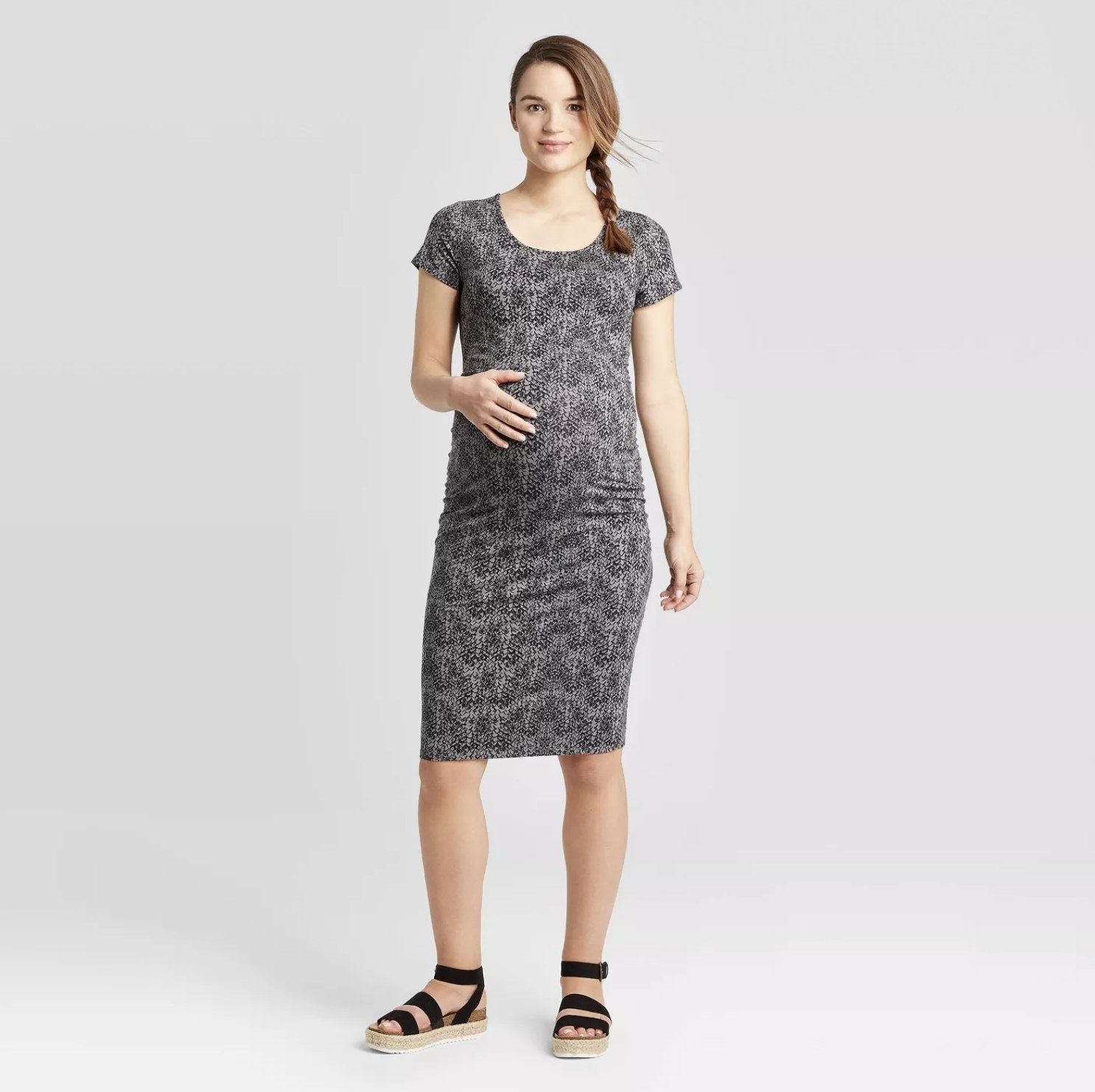 Model is wearing a black and grey snakeskin detail short sleeve maxi dress with sandals