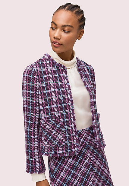 A model wearing a purple tweed blazer with two front pockets