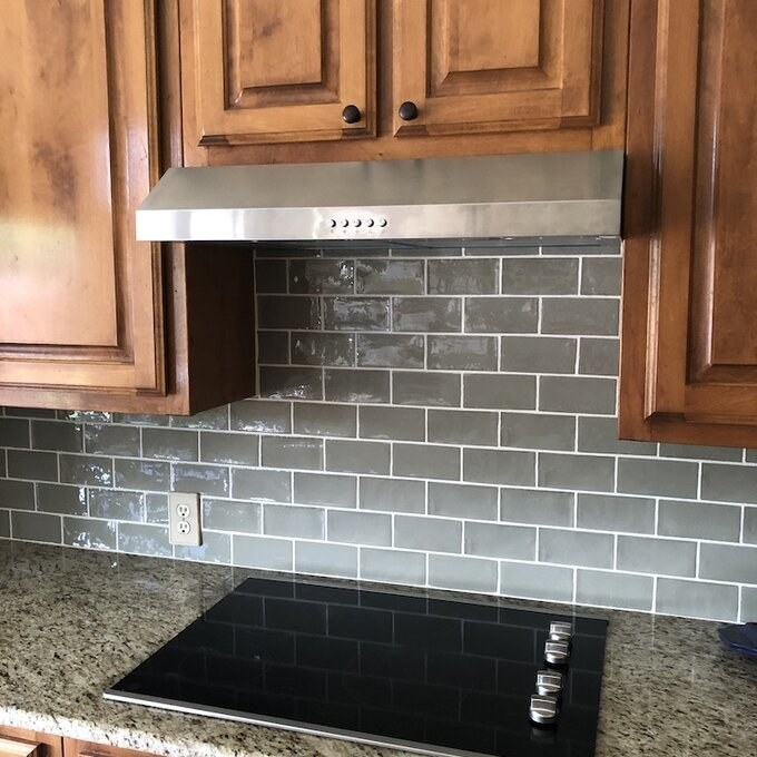 Reviewer's picture of the silver range hood