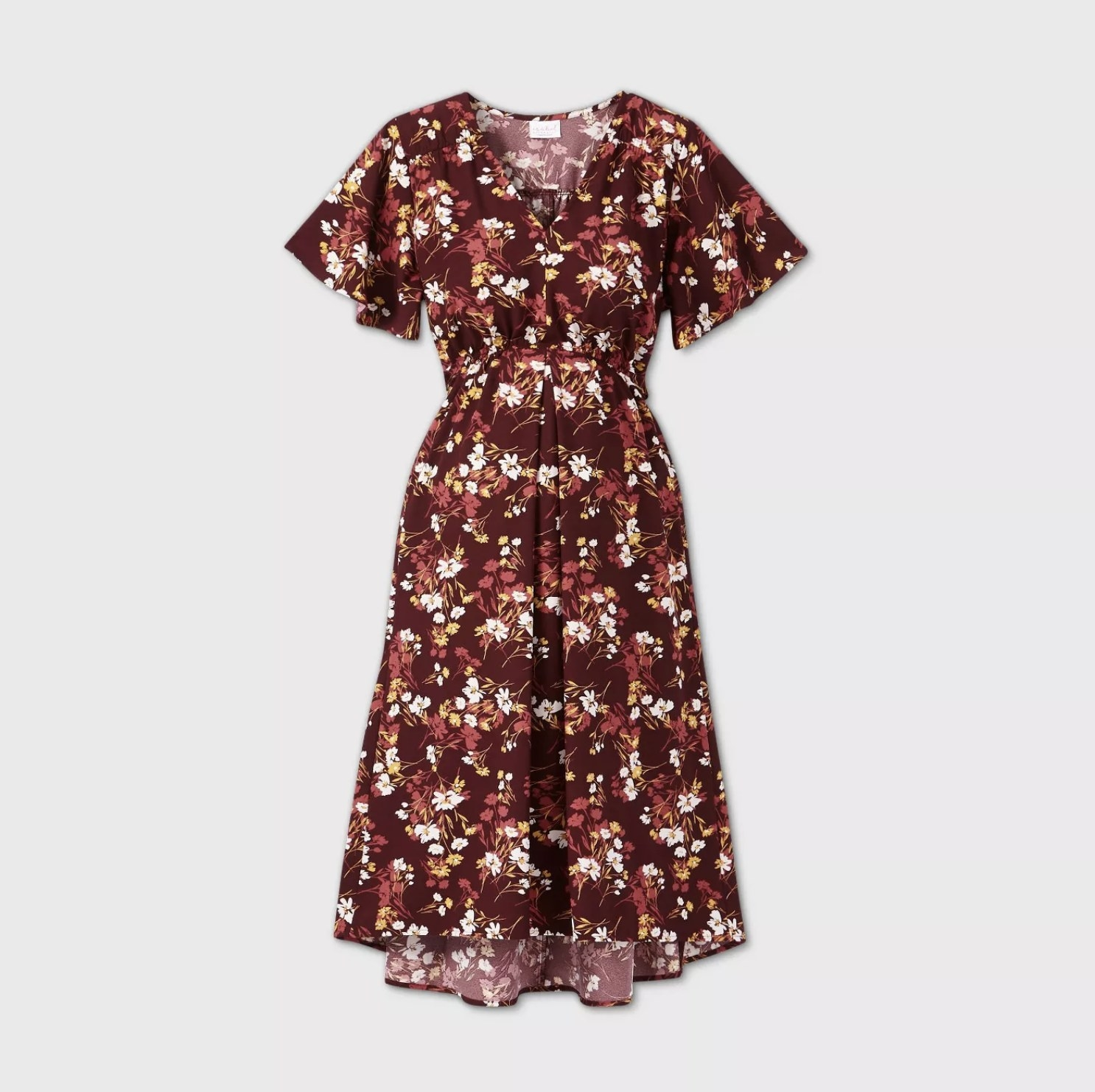 A maroon short flutter sleeve floral dress with white, cream, and red flowers throughout