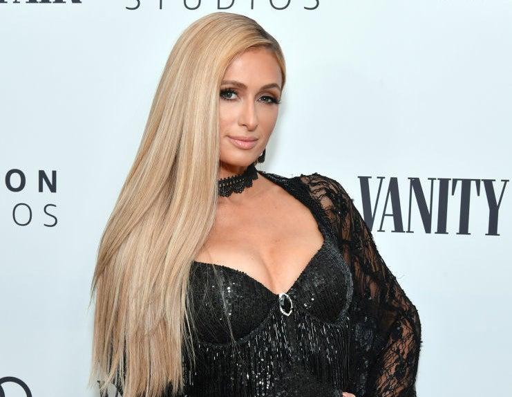 Paris Hilton poses at a Vanity Fair event