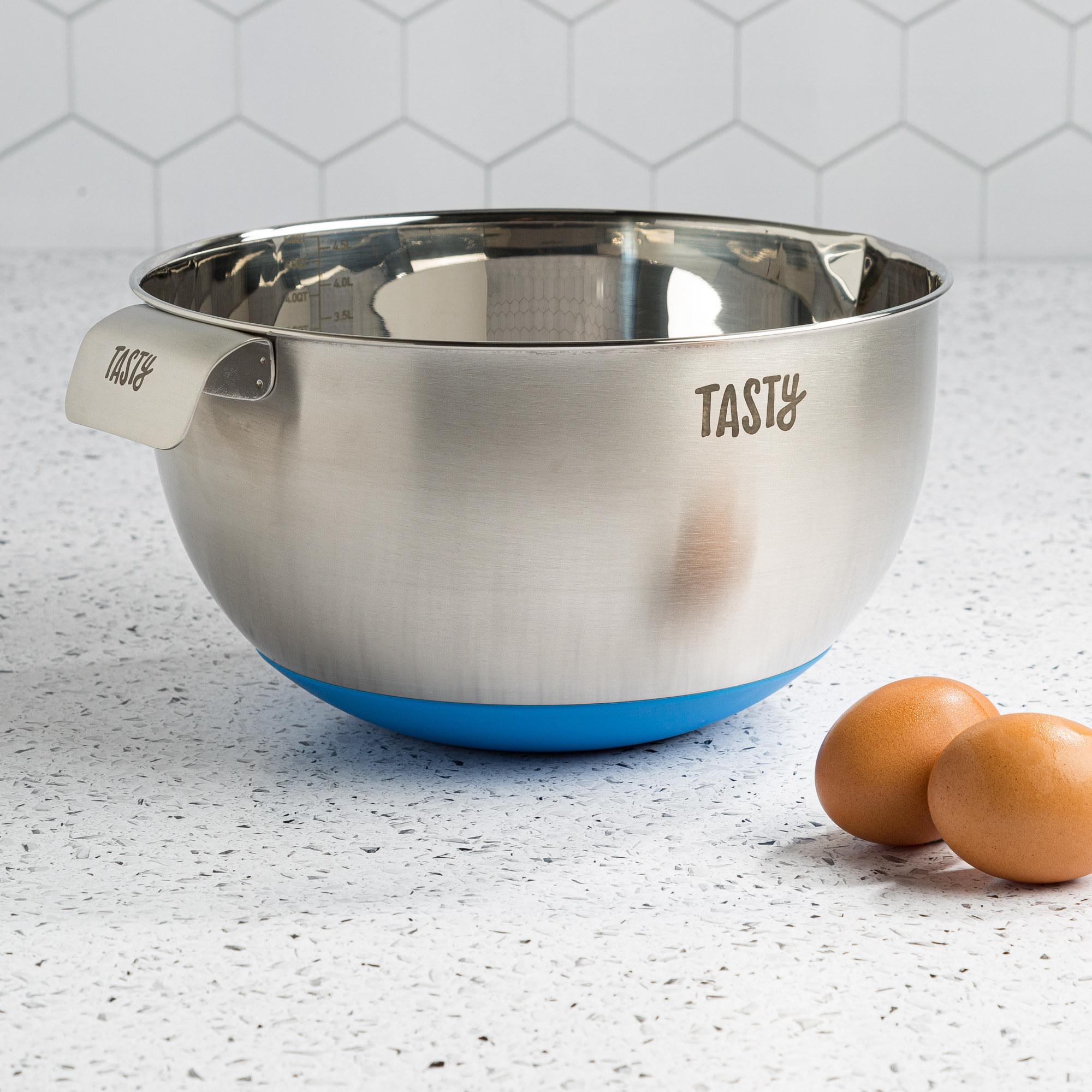 The mixing bowl displayed next to cooking ingredients