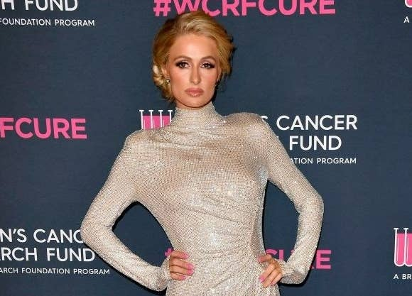Paris Hilton wears a long, turtleneck gown to a Hollywood event