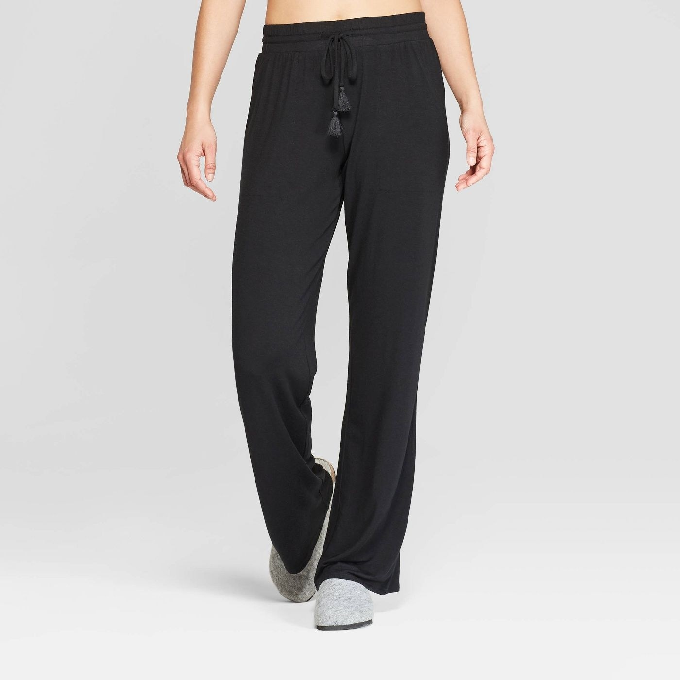 Model in black pajama pants