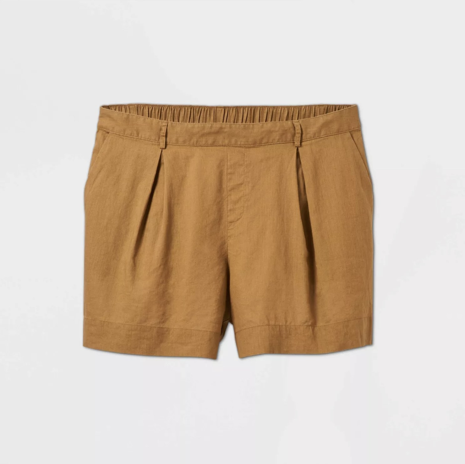 A pair of dark tan linen shorts with an elastic waist band