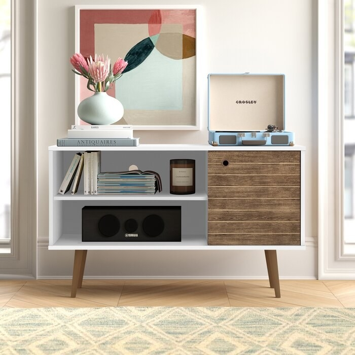 The modern TV stand with wooden peg legs